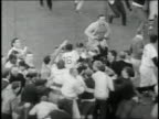 Excited Red Sox fans rush onto field and mob ball players after Red Sox win American League pennant / United States