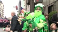 Excited viewers line the parade route / Faces in the crowd St Patrick's Day Parade at 5th Avenue NYC on March 18 2012 in New York New York