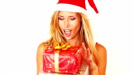 Excited young woman with christmas presents
