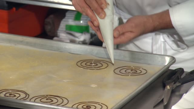 Executive Pastry Chef Thomas Henzi performs a cooking demo to showcase the dessert menu at The Beverly Hilton Unveils Menu For 70th Annual Golden...