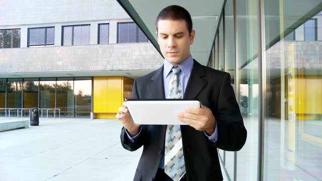 HD STEADY: Executive Using Digital Tablet