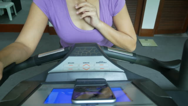 executive woman exercise and using phone