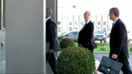 DS TS Executives Entering The Office Building