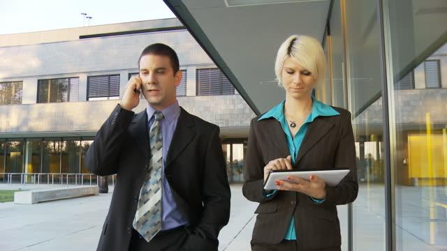 HD STEADY: Executives Walking On Office Walkway