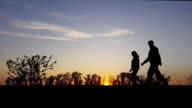 exercise silhouette in the country in the sunset
