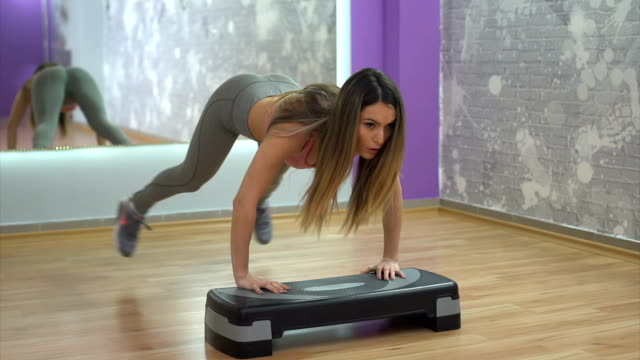 Exercises on aerobic stepper