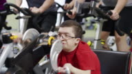 Spinning cycling class with disability
