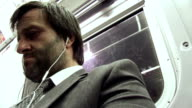 HD: Exhausted Businessman On The Subway