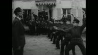 PARIS FRANCE Exiled Russian artist conducting group art lesson RUSSIAN CADET SCHOOL Young adult males children in uniforms marching in formation Male...