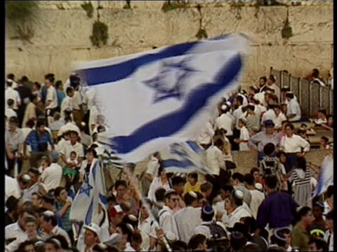 Expansion of ultra orthodox Jews OCCUPIED PALESTINE Expansion of ultra orthodox Jews ITN Jerusalem TGV Mass of Israelis gathered celebrating by city...