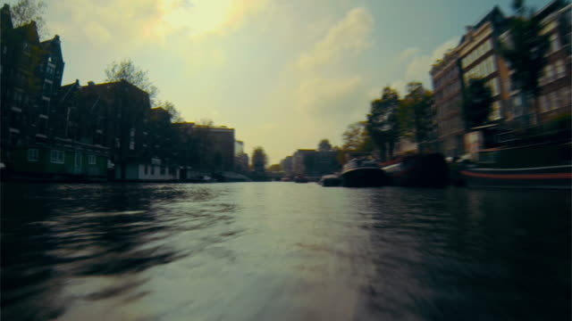 Exploring canals of Amsterdam by boat. Timelapse