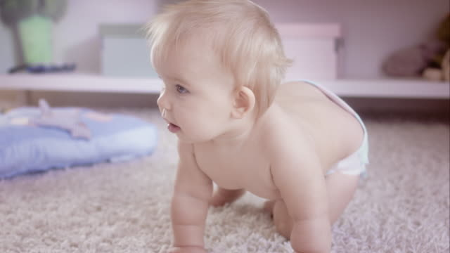 Exploring the floor- baby crawling