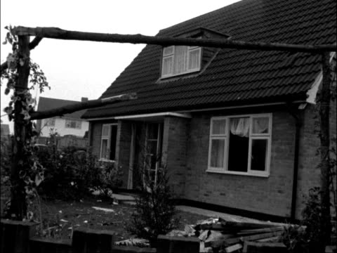 Essex Takeley EXT Various shots damage from explosion / Broken water pipe / Damaged house / Workmen at scene / Bert Laver interview SOF Bomb damage...