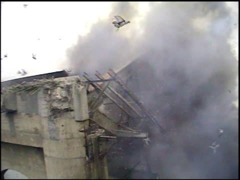 MS Explosives detonate in fiery blast on bridge and several birds visible flying away hurriedly / Bismarck, North Dakota, United States