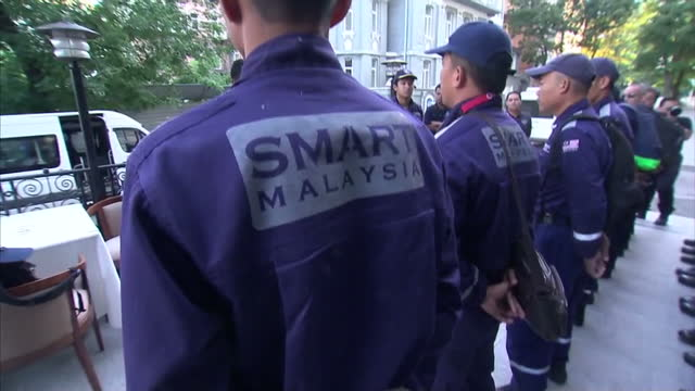 KHARKIV ext gvs Malaysian Search and Rescue team standing in lines during briefing