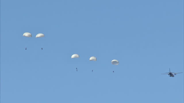 ext gvs NATO troops taking part in mass parachute drop during the Anakonda 16 joint military exercise>> on June 08 2016 in Drawsko Pomorskie Poland
