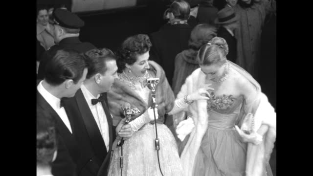 Ext theatre as celebrities arrive ABC host Dennis James hostess Maggi McNellis describe Anne Jeffreys' dress she answers husband Robert Sterling to...