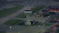 Exterior aerial evening shots of Gatwick airport planes on tarmac air traffic control tower on December 12 2014 in London England