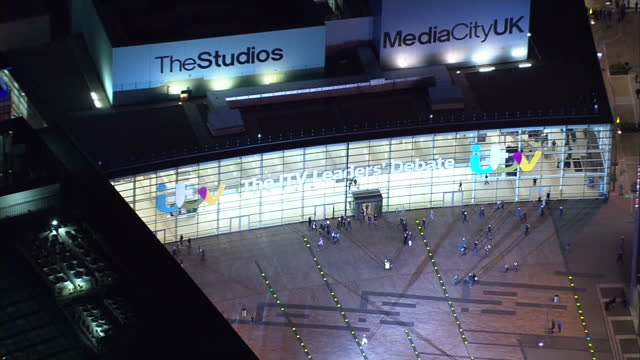 Exterior aerial night shots MediaCityUK on Salford Quays with ITV Leaders Debate branding on front of the building on April 02 2015 in Manchester...