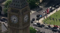 Exterior aerial shots Big Ben clock tower with Black Cab protest blocking roads in the background on June 11 2014 in London England