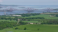 Exterior aerial shots Forth Railway Bridge over the Firth of Forth and coastline countryside on June 11th 2014 in Edinburgh Scotland