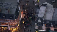 Exterior aerial shots of a large gathering of David Bowie fans gathered at a mural in Brixton of Ziggy Stardust laying flowers on January 11 2016 in...