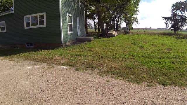 Exterior aerial shots of a rural farmhouse and surrounding farmland in Nebraska on September 19 2014 in Washington DC