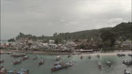 Exterior aerial shots of fishing boats beaches and shacks along Phi Phi island on August 27th 2014 in Phi Phi Thailand