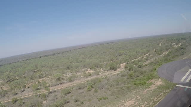 Exterior aerial shots of Kruger National Park from inside a helicopter with cutaways to the flight crew in action on December 02 2015 in Pretoria...