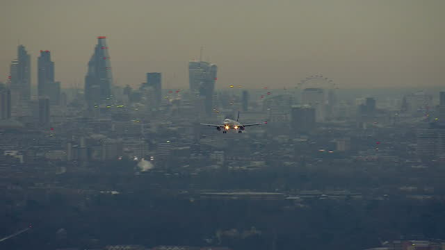 Exterior aerial shots of planes landing and on ground at London's Heathrow Airport at dusk on December 17 2014 in London England