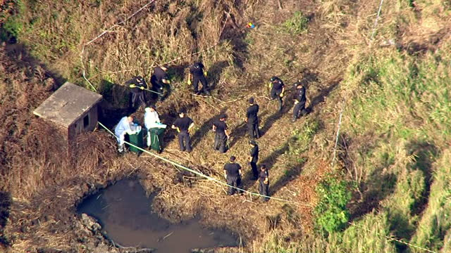 Exterior aerial shots of police and forensic detectives examining the scene of the Shoreham air disaster which killed 11 people on September 1 2015...