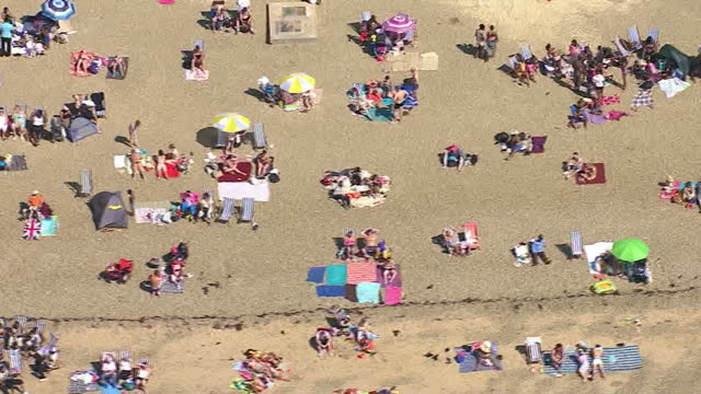 Exterior aerial shots over Southend beach with people enjoying the beach sea fun rides on the promenade Southend Beach Aerials on August 18 2012 in...