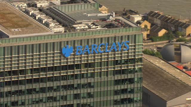 Exterior aerial shots showing Barclays Bank Headquarters at One Churchill Place Canary Wharf Incl closeups of Barclays branding on top of building on...
