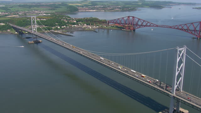 Exterior aerial shots The Forth Road bridge over the Firth of Forth Includes shots of cars driving over bridge on June 11th 2014 in Edinburgh Scotland