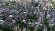 Exterior aerials of the Houses of Parliament and over central London including the River Thames and Westminster