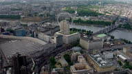 Exterior aerials of the River Thames along the Embankment the London Eye and the Houses of Parliament in the city of London