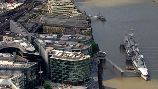 Exterior aerials Tower Bridge over the River Thames and City Hall building in the city of London