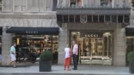 Exterior and signage shots of the Gucci store on Madison Avenue in Manhattan New York Shots of commuters and shoppers walking past the front entrance...