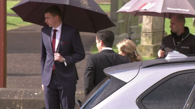 Exterior back view Tim and Lucy Henman arrive at Andy Murray's wedding on April 11 2015 in Dunblane Scotland