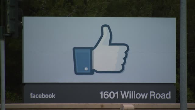 Exterior BRoll of Facebook headquarters in Menlo Park CA / Thumbs Up sign at 1601 Willow Road / Office buildings / Highway traffic / People biking...