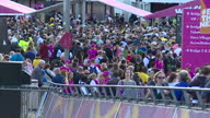 Exterior busy shots of crowds arriving at the Olympic Stadium for the World Athletics Championships 2017 walking some taking selfies and wearing...