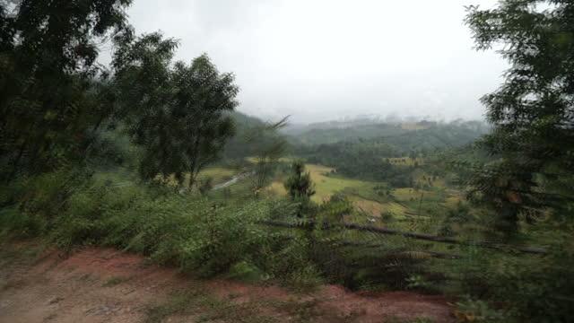 Exterior driving shots through the Burmese countryside through rural farmland and misty mountains on November 05 2015 in Yangon Burma