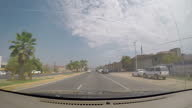 Exterior driving shots through the streets of Culiacan as the driver is pulled over by masked armed Mexican anti drugs police on June 04 2015 in...