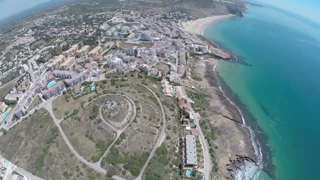 Exterior drone aerial shots over the Portugese holiday resort of Praia da Luz showing villas swimming pools and beaches on June 08 2014 in Praia da...