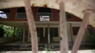 Exterior footage of an abandoned building in the town of Aguas Buenas Puerto Rico on July 9 2017 Shots wide exterior of entire building wide shot...