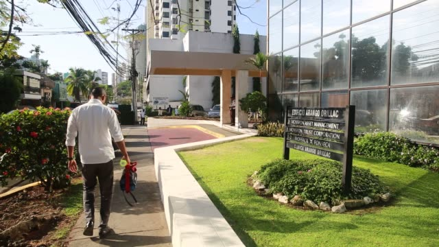 Exterior footage of Clínica Arango Orillac in Panama Panama on April 5 2016 Shots pan right of front lawn and sign CU pan right of clinic sign on...