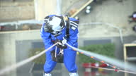 Exterior high shot person abseil down The Gherkin London City skyscraper on September 07 2015 in London England