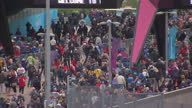 Exterior high shots large crowds of people walking into the Olympic Park for the Paralympic Opening Ceremony Crowds Walking into the Olympic Park on...