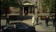 Exterior high shots Prince Charles Camilla Duchess of Cornwall get out of car walk into Canongate Kirk church briefly waving to the press as they...