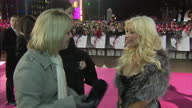 Exterior interview Christina Aguilera on the red carpet at the premiere of Burlesque Christina Aguilera interview at Burlesque premiere on December...